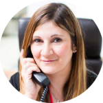 Dee-Savvas-Practice-Manager on a phone with a client