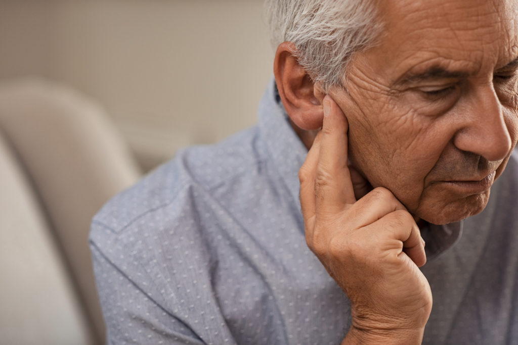 Man Suffering from Unilateral hearing loss